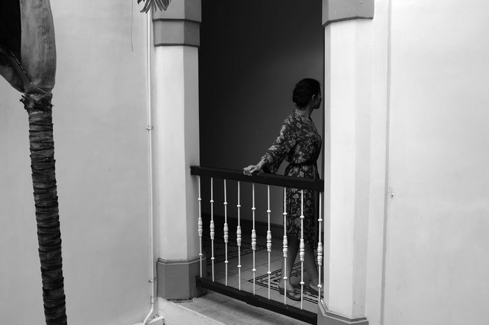 Architectural Column Art Deco Architecture B&W Portrait Balcony Black And White Book Cover Day Faceless Portrait Fujifilm_xseries Hotel Lobby Java Indonesia Looking Away Mysterious Mood Portrait Of A Woman Soft Light Standing At The Balcony  Surabaya Woman In A Dress The Week On EyeEm Editor's Picks