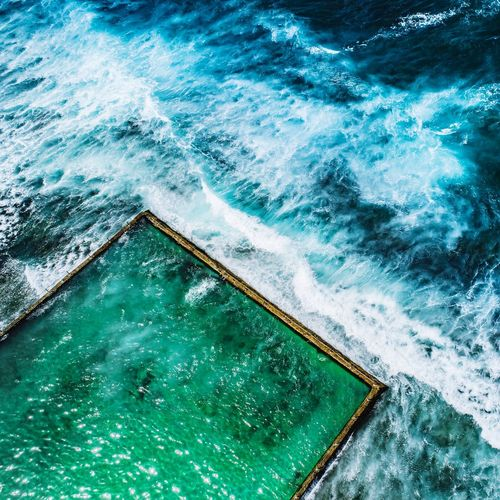 High angle view of infinity pool by sea
