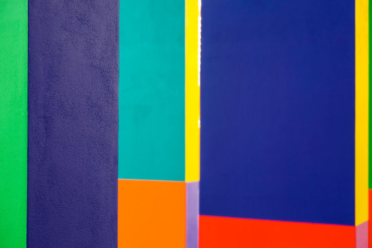 Abstract geometric pattern on concrete wall Architecture Art And Craft Equipment Backgrounds Blue Built Structure Choice Close-up Copy Space Creativity Day Flag Full Frame Indoors  Multi Colored No People Pattern Striped Variation Vibrant Color Wall - Building Feature Yellow