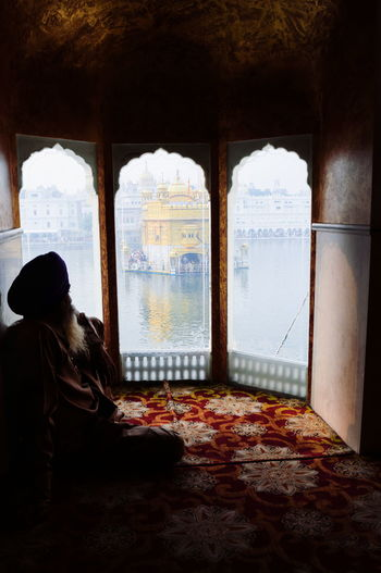 A devotee listens to hyms from the Guru Granth Sahib (Sikh holy book) at Golden Temple, Amritsar in Punjab, India. InMakin! Sikh Sikhism Sikh Temple Golden Temple Amritsar Punjab India Peace And Quiet Religious Architecture Worship My Unique Style Colourful Perspective People Watching Light And Shadow Darkness And Light Wh Exploring Style Chance Encounters State Of Mind  Candid Positive Vibes Spirituality Religion Sillhouette My Year My View Finding New Frontiers Adapted To The City Uniqueness Miles Away Long Goodbye The Secret Spaces TCPM Live For The Story Place Of Heart The Architect - 2017 EyeEm Awards Breathing Space