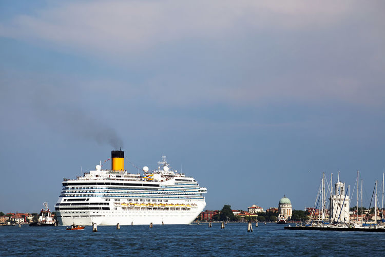 Cruise ship on sea against blue sky