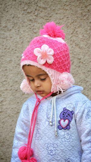 Cute girl wearing warm clothing during winter