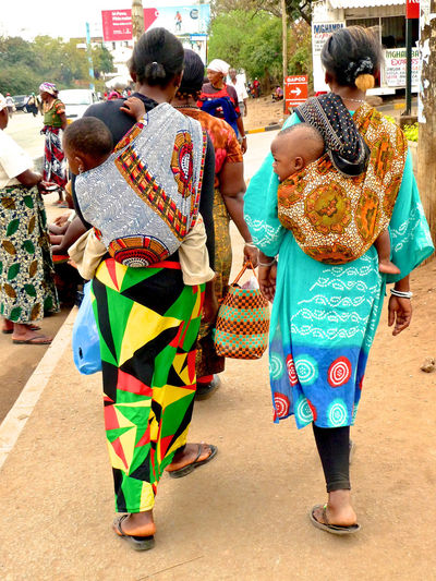 Africa African Colors Carrying Baby Children Day From Behind Kilimanjaro Lifestyles Moshi Mother Mothers Multi Colored Outdoors Patterns Piggyback Street Photography Symmetry Tanzania Travel Unrecognizable Person