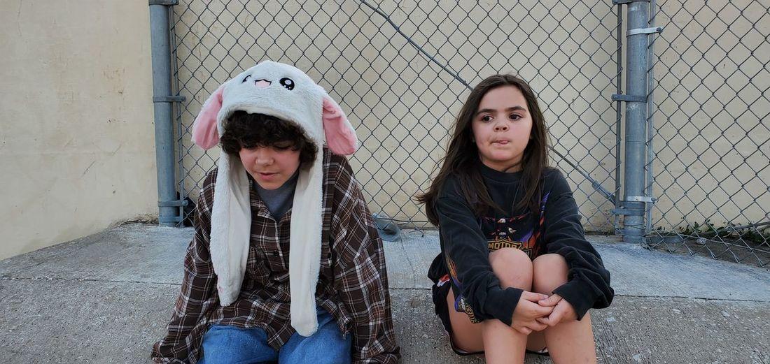 Full length of girl sitting on fence