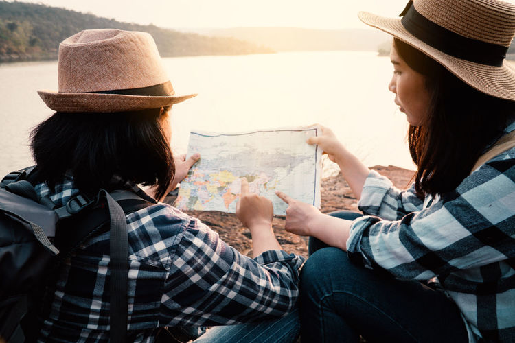 Travel Vacation Holiday Relaxing Rest Destination Nature Backpack Bag Journey Tourism Two People Real People Women Leisure Activity Lifestyles Sitting Outdoors Map Adventure