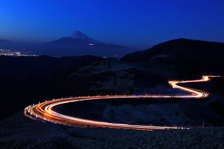 Fuji Mountain japan Blurred Motion City Curve Dusk High Angle View Illuminated Light Light Trail Long Exposure Mode Of Transportation Motion Mountain Mountain Range Nature Night No People Outdoors Road Scenics - Nature Sky Speed Transportation Vehicle Light Winding Road