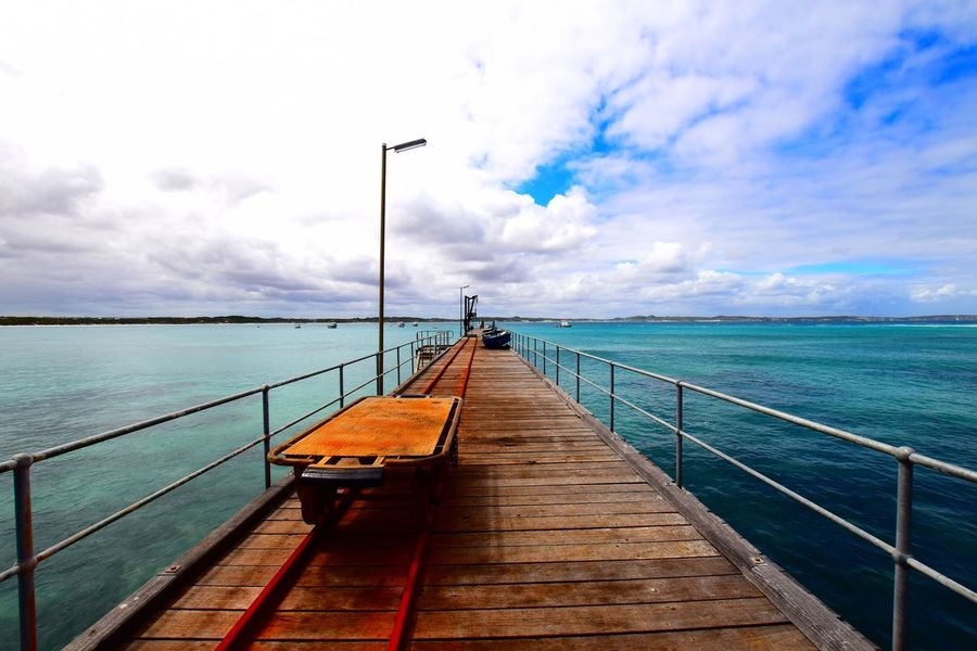 EyeEmNewHere Vivonnebay Ocean View Perspective Dockside Rusty Blue Breathtaking Calm Peace And Quiet Fishing Sky And Clouds Sea And Sky
