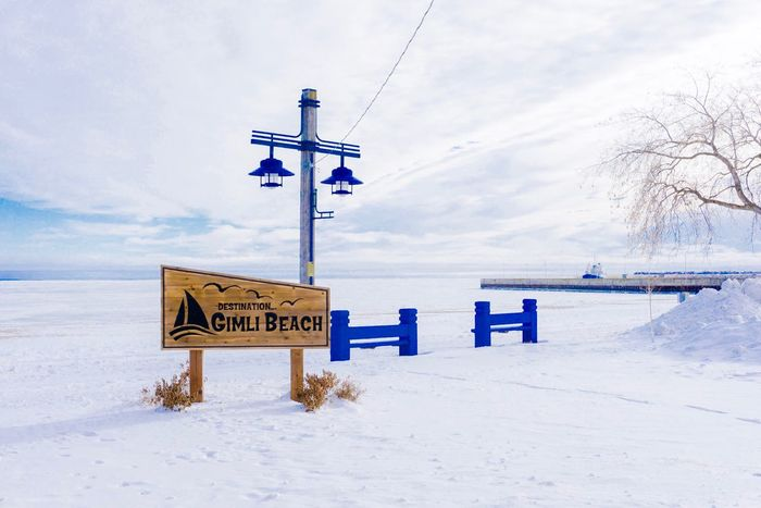 FRozen beach Winter Cold Temperature Snow Weather Communication Sky Nature Cloud - Sky No People Outdoors Day Guidance Tranquility Direction Scenics Road Sign Beauty In Nature