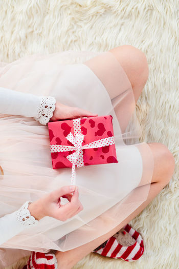 Close-Up Of Girl Opening Present