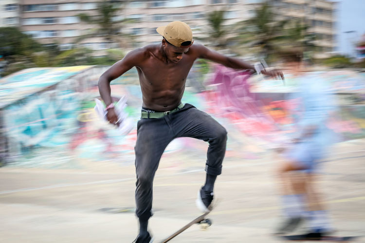 Skater Durban Beachfront Skateboarding Skatepark The Week on EyeEm Blurred Motion Day Durban Skatepark Healthy Lifestyle Lifestyles Motion One Person Outdoors Real People Shirtless Skateboard Skateboard, Sport, Skateboarding, Skateboarder, Leisure, Skate, Park, Fun, People, Skater, Lifestyle, Outdoor, Active, Skating, Horizontal, Culture, Recreation, Board, Youth, Urban, Old, Healthy, Spirit, Youthful, Activity, Balance, Close-up, Extreme, Sty Skateboarder Skater Speed Sport Adventures In The City