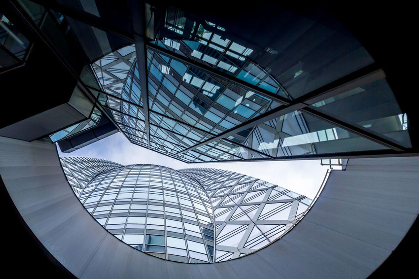 Modern facade of glass with cloudy sky and reflections Abstract Architecture ASIA Blue Building Business Finance And Industry Corporate Business Economics Economy Financial District  Futuristic Futuristic Architecture Glass Global Modern Architecture Sky Skyline Skyscraper Tall Tokyo,Japan Urban Windows