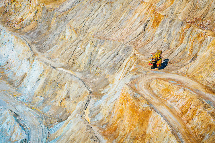 High angle view of mining vehicle on rock in quarry