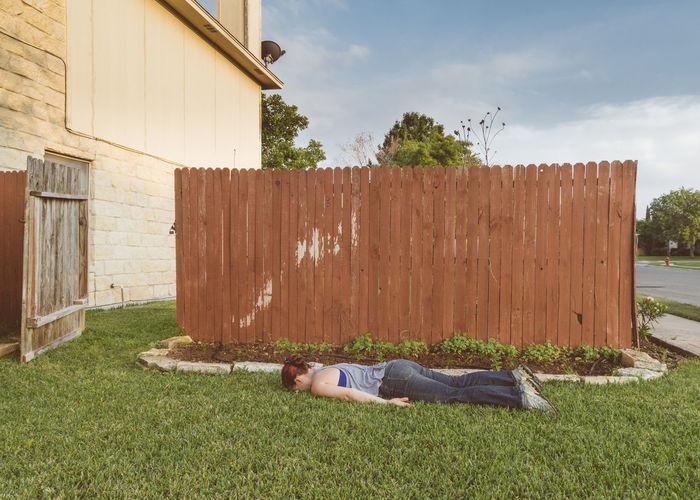 Woman lying on field