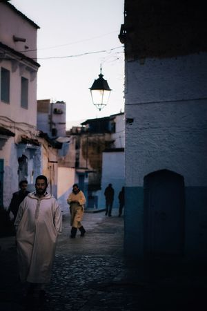 Chefchaouen Blue City Dusk Morocco Building Exterior Architecture Built Structure Group Of People Full Length Lifestyles People The Street Photographer - 2018 EyeEm Awards