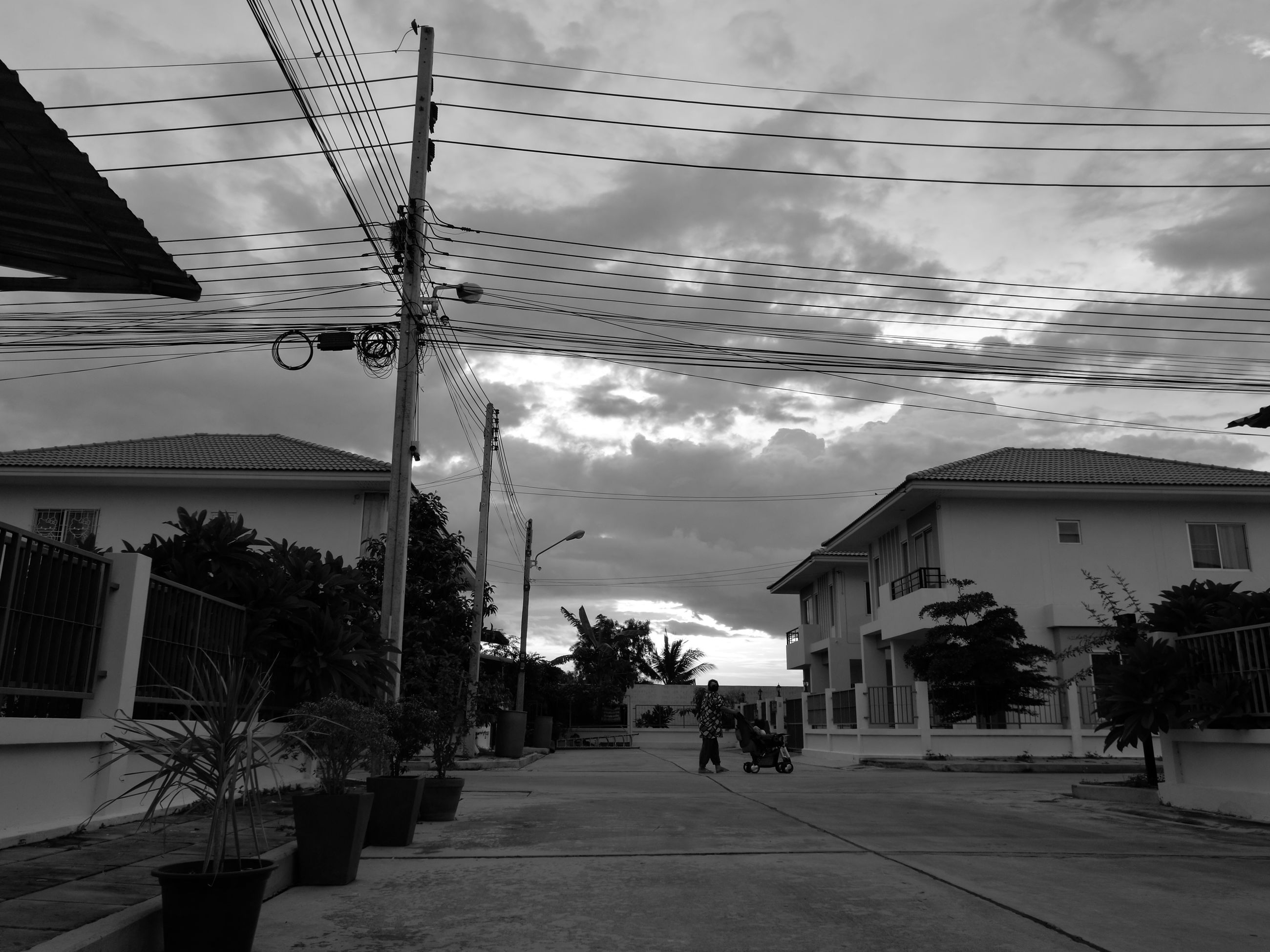 architecture, built structure, sky, power line, the way forward, cloud - sky, cable, cloud, city, residential building, day, building, cloudy, outdoors, diminishing perspective, no people, vanishing point, town, power supply