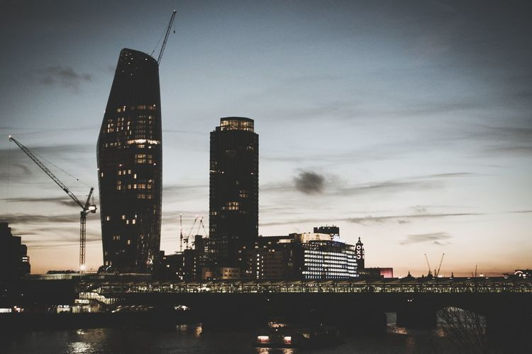 Architecture Dusk Skyscraper Business Finance And Industry Building Exterior Sky No People Illuminated Urban Skyline Travel Destinations Outdoors Built Structure Modern City Night Sunset Industry Water Cityscape