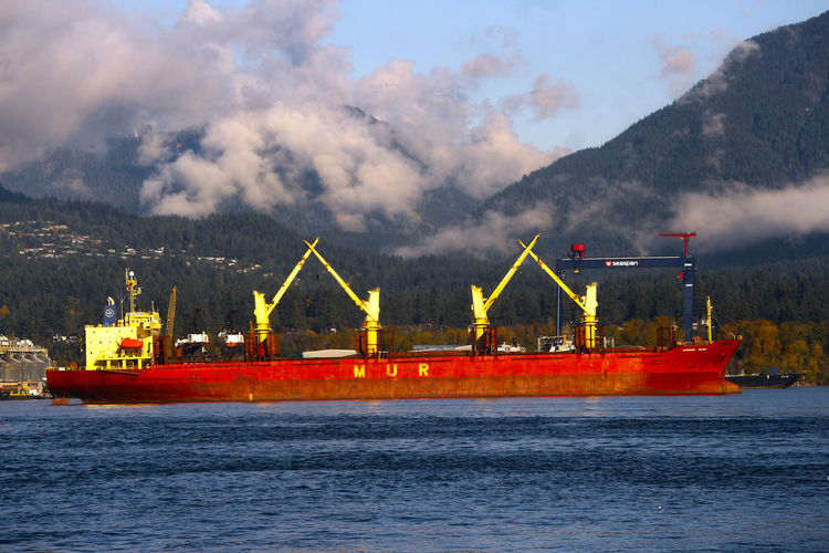 Cargo ship moored in Burrard Inlet near Vancouver B.C. Canada. Freight Transportation Cloud - Sky Water Shipping  Sea Outdoors Nautical Vessel Vancouver Ship Harbor
