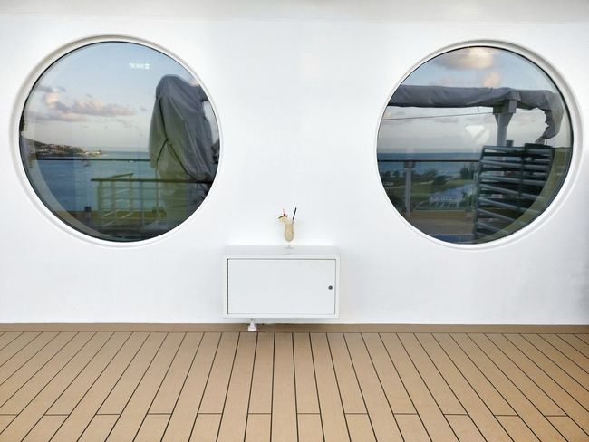No People Built Structure Architecture Building Exterior Tranquil Scene Scenics Round Window Round Windows Cocktail Still Life On A Ship Leisure Design Minimalism Two Round Windows Synchronicity Reflection Vacation Cruise Ship Minimalist Architecture Sommergefühle EyeEm Selects