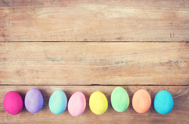 Vintage colorful easter eggs on wood table background Multi Colored Wood - Material Directly Above Group Of Objects Table Egg Easter Egg Celebration Easter Holiday Colorful