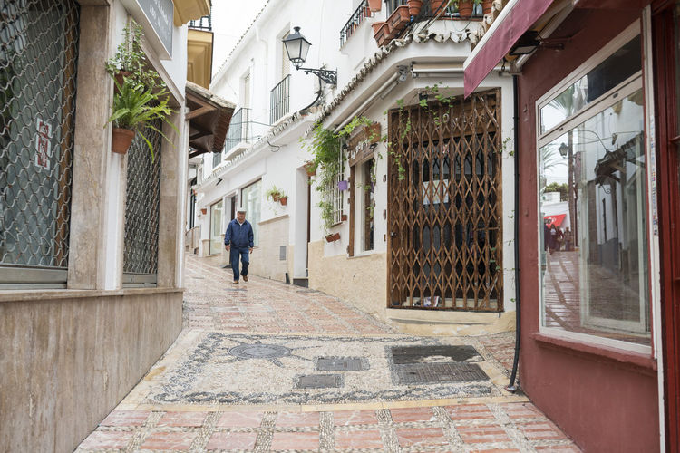 Marbella MarbellaOldTown Old Town SPAIN Architecture Spanish Architecture Holiday Destination Vibrant Color Building Exterior Built Structure One Person Building Real People Day Walking Window Men City Full Length Incidental People Lifestyles Adult Footpath Street Alley