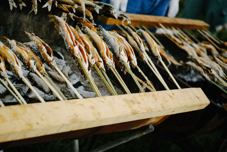 High angle view of fish being prepared on barbecue