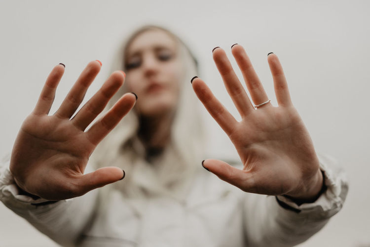 Portrait of human hand against gray background