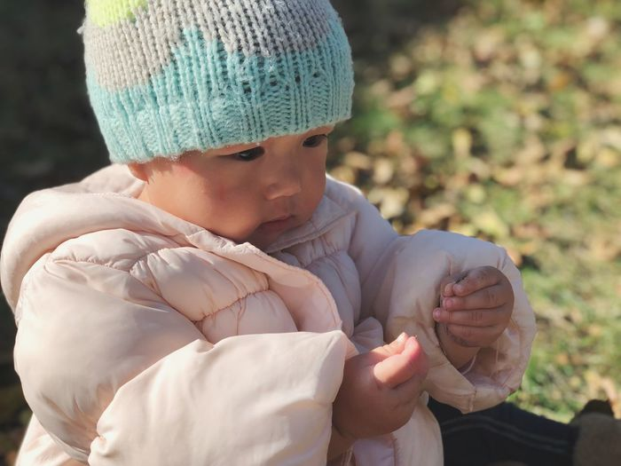 Close-up of baby on field