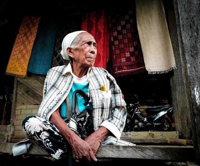 Senior poor woman looking away