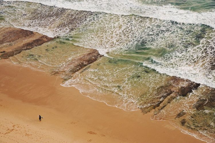 Low Tide Portugal Algarve Ocean Surfer Low Tide Surf Land Beach Sand Water High Angle View Sea Beauty In Nature Aquatic Sport Surfing Wave Travel Tranquil Scene
