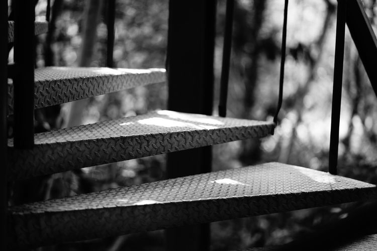 Close-up of empty bench on table