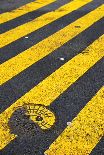 High angle view of zebra crossing sign on road