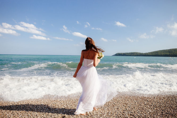 bride on beach trash the dress Honeymooning Relaxing Trash The Dress Vacations Wedding Wedding Photography Beach Bride Honeymoon Honeymooners Leisure Leisure Activity Nature Ocean Relaxation Sand Sea Sea And Sky Seascape Sun Vacation Wave Wedding Dress
