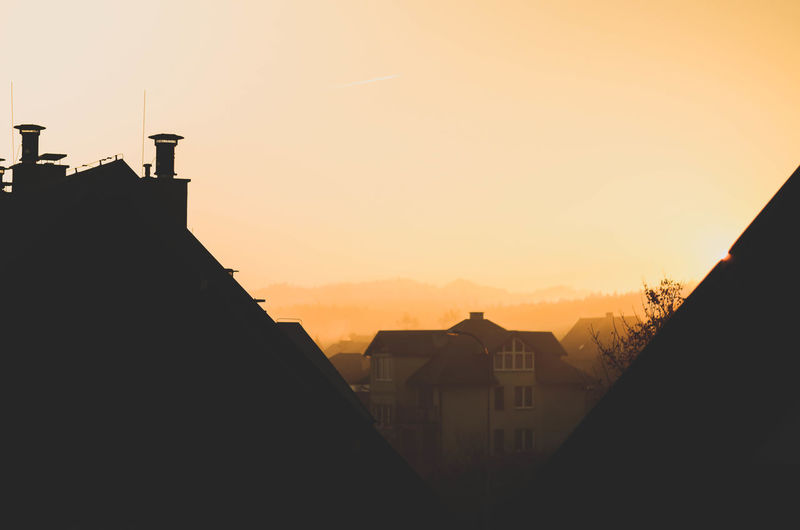 Architecture Built Structure Building Exterior Sky Silhouette Building Sunset Nature No People City Orange Color Residential District House Outdoors Copy Space Sunlight Roof Religion Spirituality Town Poland Poland Eyeem Kaszuby Morning Good Morning