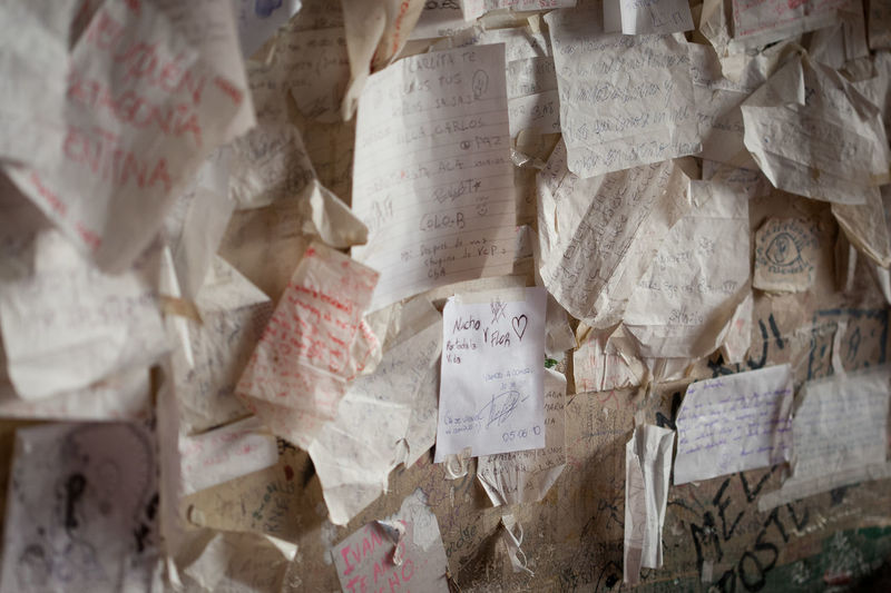 walls of a traditional bar cordoba that look full of papers with messages and love letters from their customers. Argentina Bar Indoors  Letters Part Of Poeme Single Object Text Wall