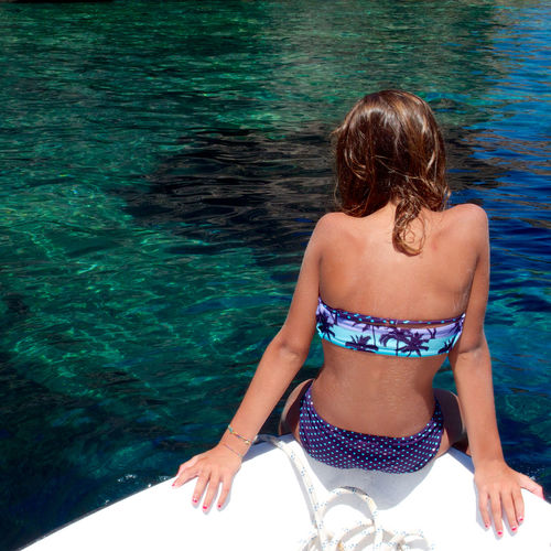 Palmarola Bikini Boat Carefree Enjoyment Full Length Green Water Happiness Holidays Island Italy Leisure Activity Lifestyles Palmarola Person Perspective Portrait Real People Relaxation Sea Sitting Summer Three Quarter Length Weekend Activities Young Adult Young Women