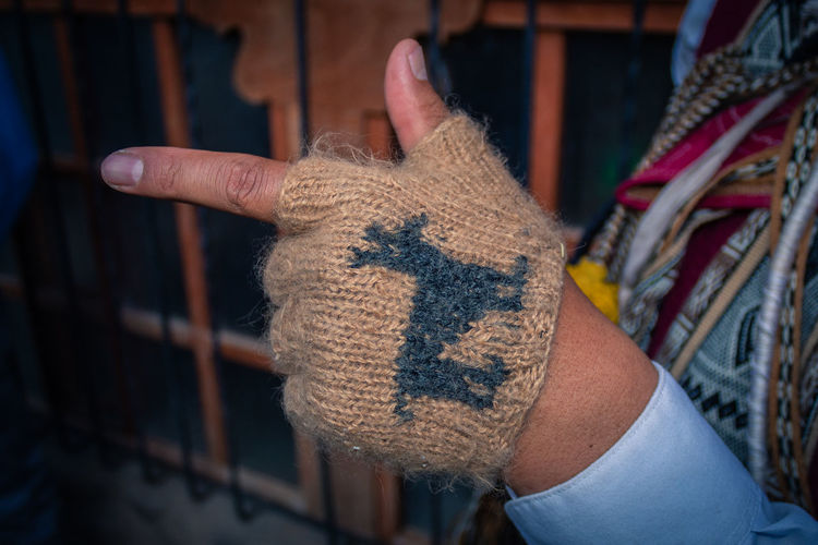 Close-up of person wearing burlap glove