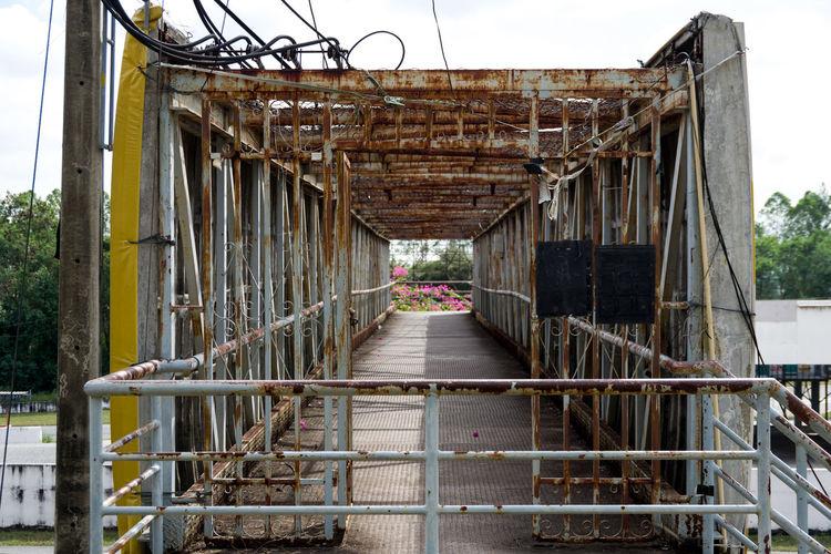 Bridge over old building against sky