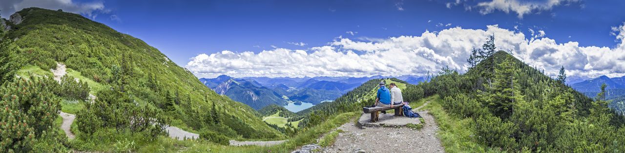 Couple on a hiking tour taking a rest Bavaria Couple Hiking Holidays Tirol  Vacations Activity Adventure Alps Bayern Herzogstand Jochberg Kochelsee Leisure Activity Mountain Range Mountains Outdoors Panoramic Scenics - Nature Summer Take A Break Tour Tranquil Scene Tranquility Walchensee