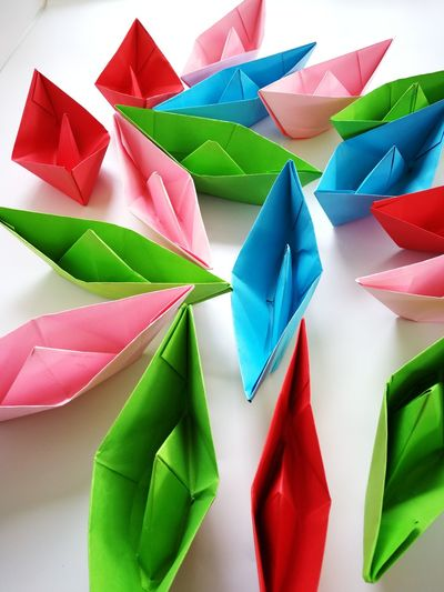Multi Colored Paper Variation Art And Craft Close-up Green Color Origami Paper Boat Full Frame Detail Backgrounds Textured  Repetition Colorful Large Group Of Objects Pinwheel Toy ArtWork Paper Airplane For Sale Colored Pencil Crane - Bird
