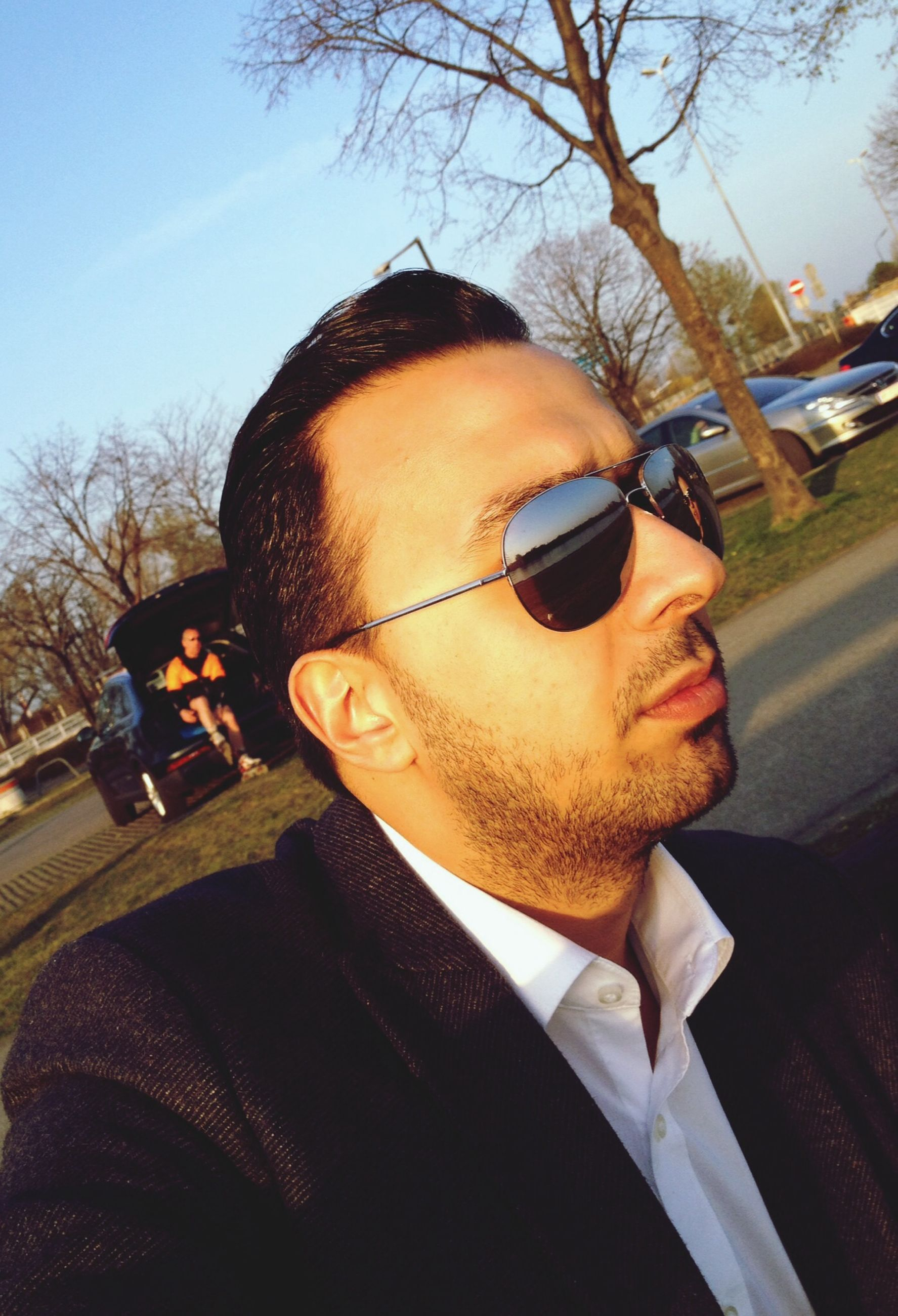 young adult, sunglasses, person, lifestyles, portrait, looking at camera, young men, leisure activity, headshot, front view, mid adult men, car, mid adult, casual clothing, eyeglasses, beard, head and shoulders, transportation