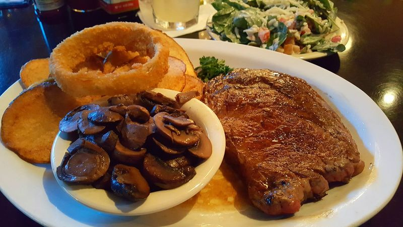 Ribeye with fried potatoes and spinach salad. Ribeye Steak Plate dinner Restaurant food Meat grilled Seared fried potatoes Spinach Salad eating out Dining S6Edge Plus