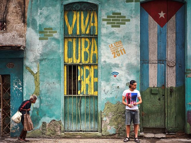 In Havana there was this guy with a american flag on his shirt in front of the Cuban Flag. nice coincidence, great message! Cuba Cuba Libre Cuban Flag American Flag Peace People Together Showcase July Berlin Photographer Streetphotography The Week Of Eyeem Street Photography Found On The Roll Travel Photography Streetphoto_color Viva Cuba! Color Of Life Eyeemphoto Color Palette Snap a Stranger EyeEm Diversity The Street Photographer - 2017 EyeEm Awards