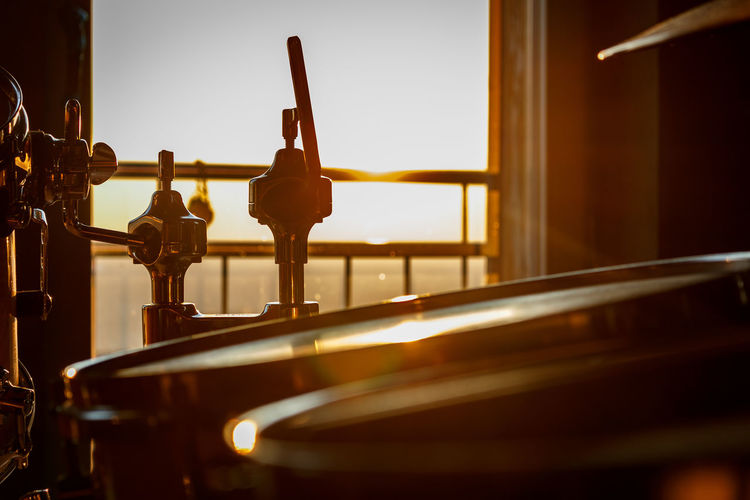 Drumkit during sunset Aesthetics Beautiful Bright Camera Colors Composition Music Shine Art Canon Close-up Drums Focus On Foreground Indoors  Instrument Light And Shadow Music Musical Instrument Sun Sunset First Eyeem Photo