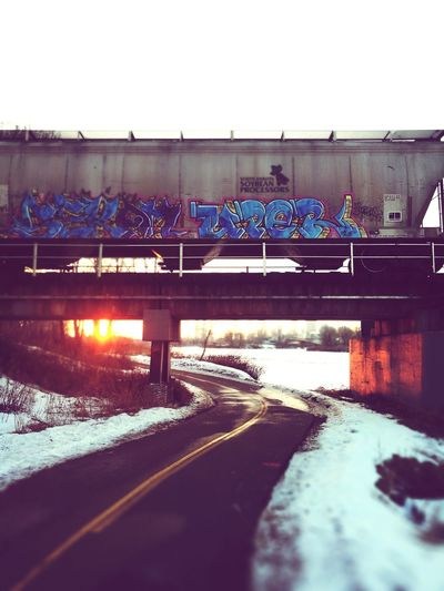 Bow river & Train ⚫⚫ Outdoors Winter Nature Bridge - Man Made Structure No People Day Snow Graffiti Graffiti Art Graffititrain Train Calgary, Alberta Calgaryphotographer Bow Valley Freshness Sunset