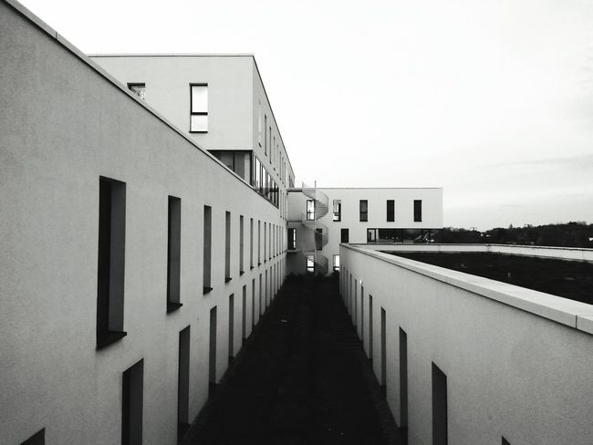 Architecture Built Structure Building Exterior Outdoors Day Sky No People Politics And Government City Prison Geometry Simmetry Blackandwhite Bw Vanishing Point Straight Tension Lines Minimalism Monochrome Windows Background Bauhaus Germany Perspective Perspectives On Nature Postcode Postcards Black And White Friday The Graphic City