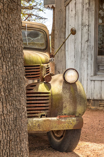 Old rusty truck and an old barn Texas Truck Auto Post Production Filter Automotive Photography Vintage Vintage Car Rusty Rusty Metal Rustygoodness Barn Barn Find Retro Retro Styled Farm Rural Scene Abandoned Abandoned Places Travel Travel Destinations Mode Of Transportation Transportation Land Vehicle Day Tree Motor Vehicle Car Trunk No People Tree Trunk Old Damaged Obsolete Metal Outdoors Nature Deterioration