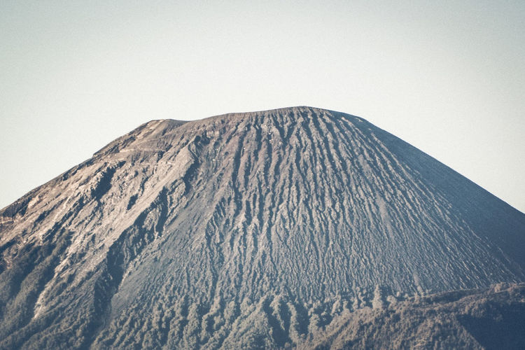 Scenic view of volcanic mountain against clear sky
