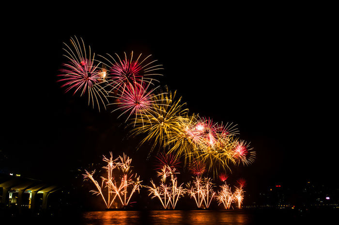 July 1st fireworks in Hong Kong Arts Culture And Entertainment Celebration Celebration Exploding Firework Firework Display Hong Kong Illuminated Illuminated Signs July 1st Low Angle View Multi Colored Night No People Outdoors Sky Victoria Harbour Neon Life