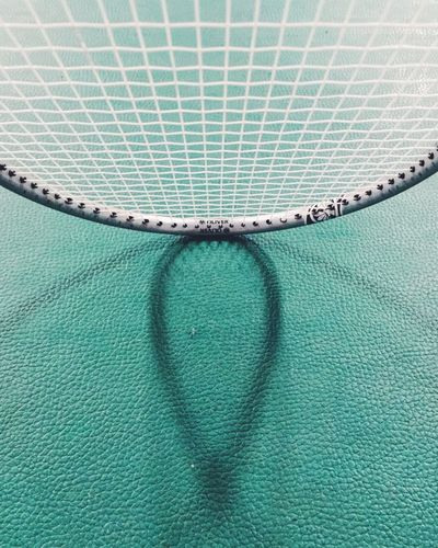 High Angle View Of Racket On Field
