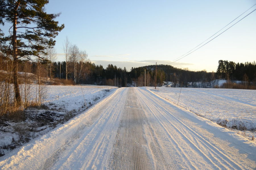 Just start walking down the road.... Beauty In Nature Cold Temperature Country Road Countryside Day Ice Road Landscape Nature No People Outdoors Road Sky Snow Snow Road Travel Tree Winter Winter Road